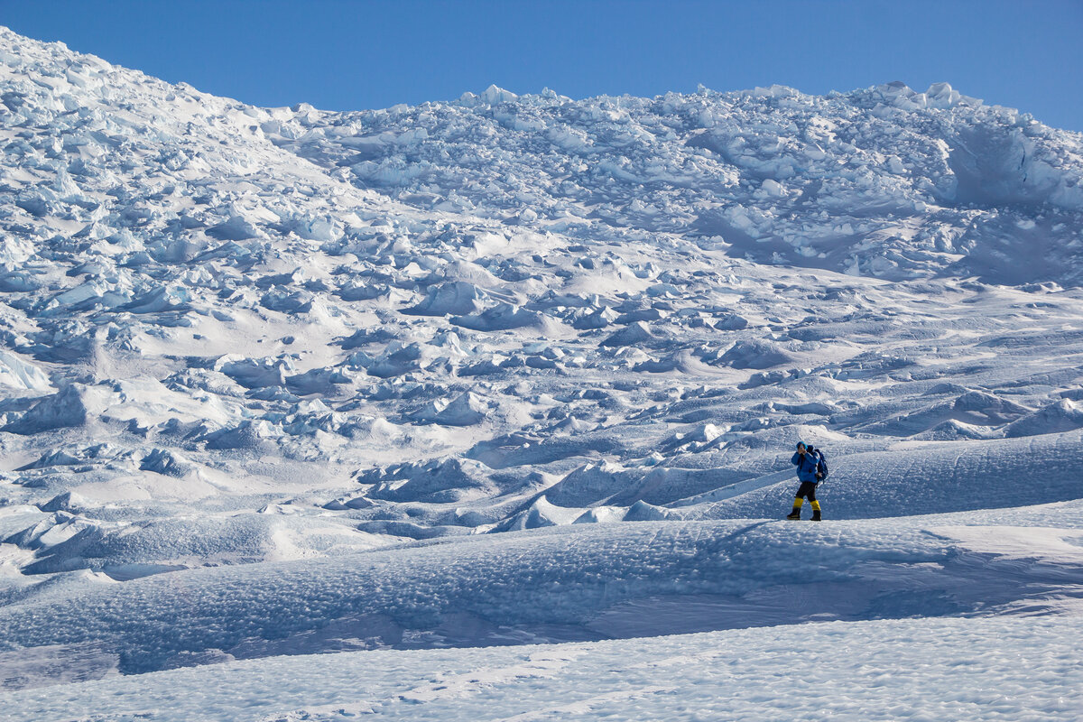 Hiker below the jumbled ice of the Drake Icefall