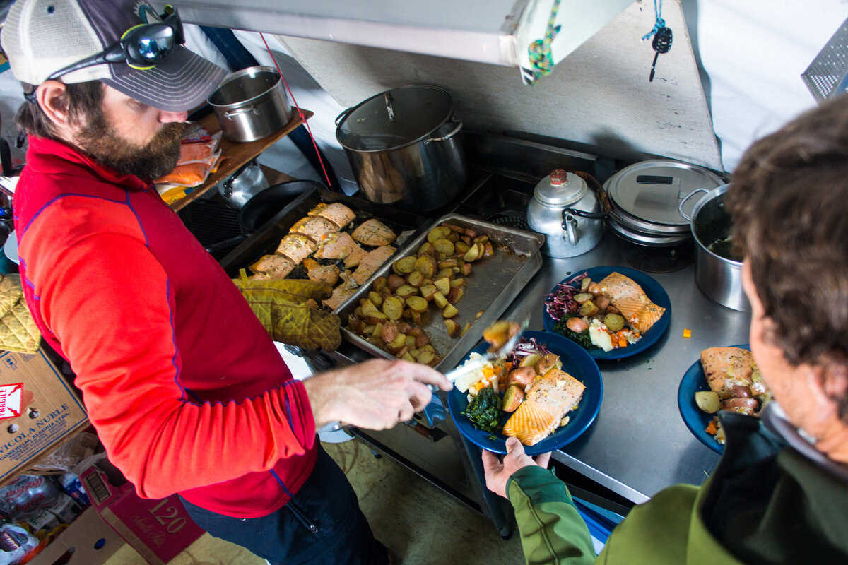 ALE guide Chris N. serves up dinner in base camp