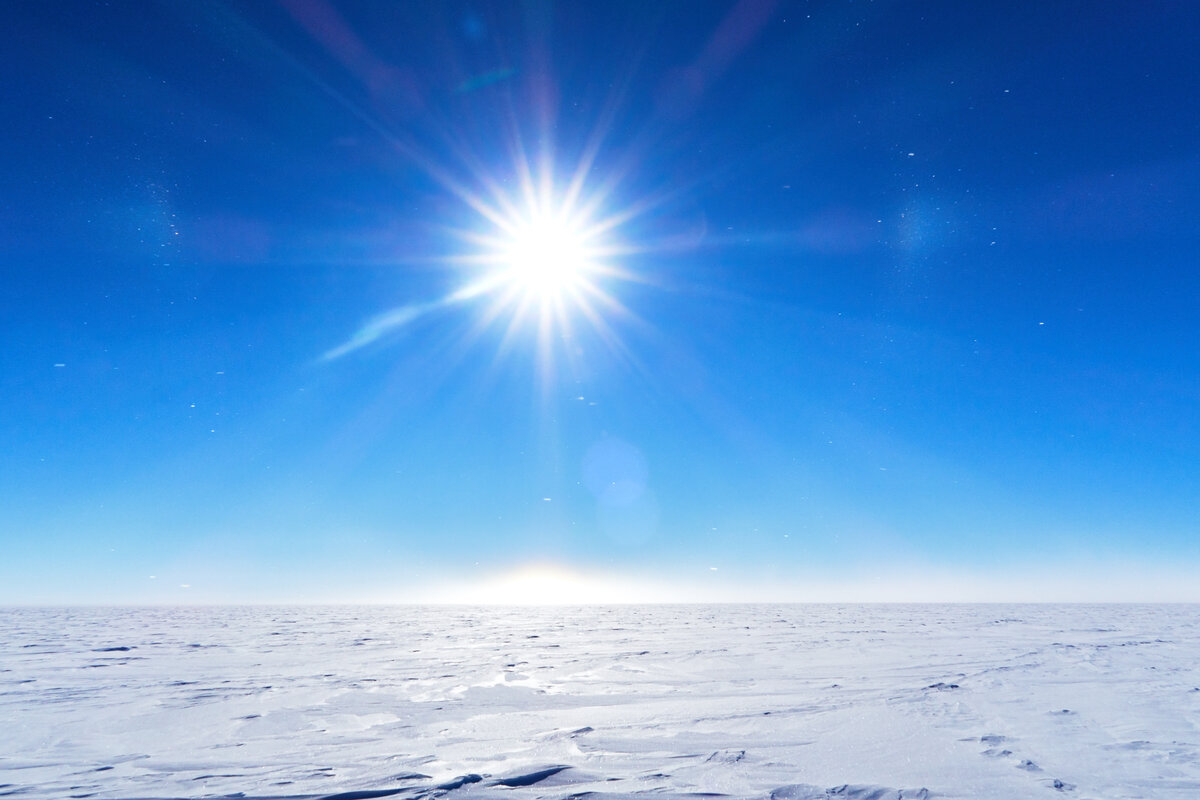 White polar plateau on a perfect blue sky day