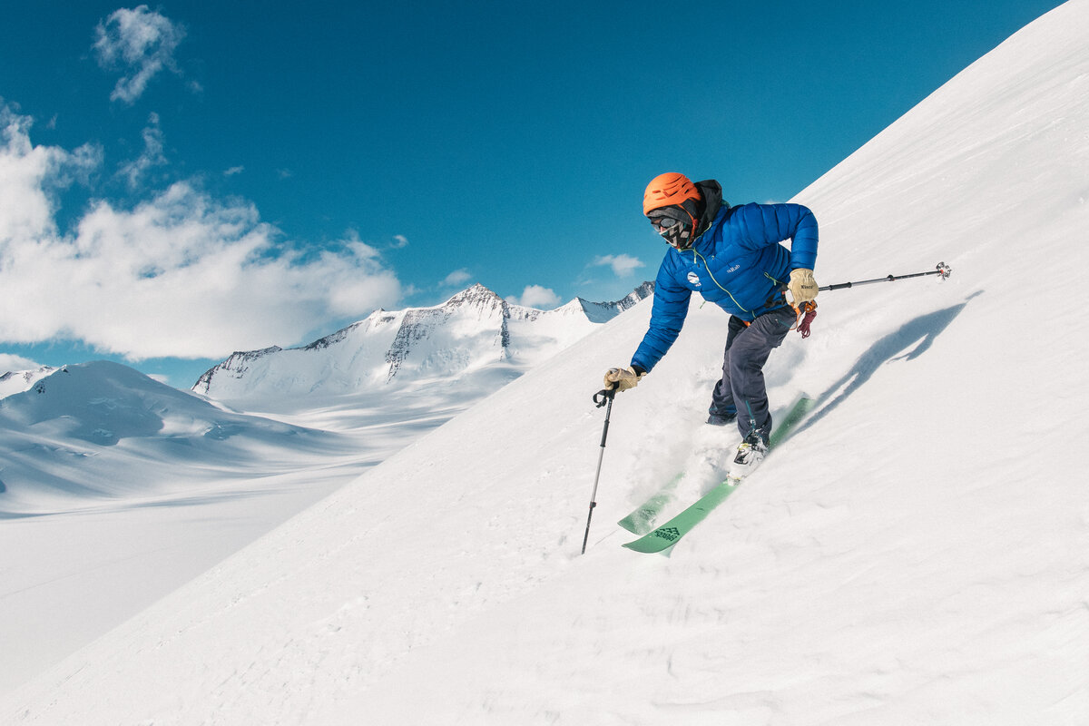A skier descends the slope above Three Glaciers