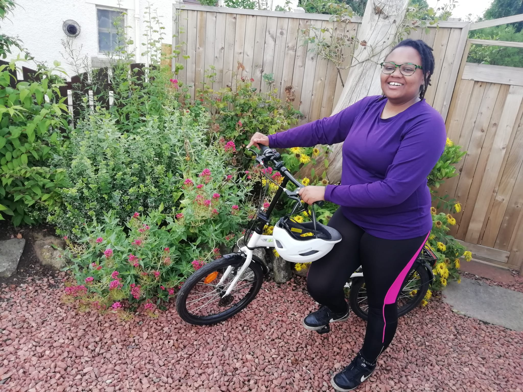 Asinath with her bike