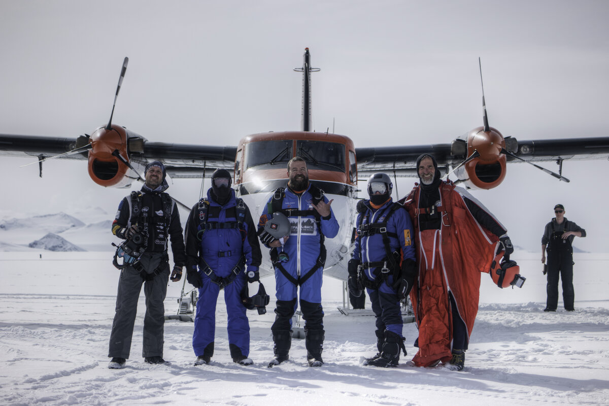 Skydive Antarctica guests pose for a photo in front of the Twin Otter