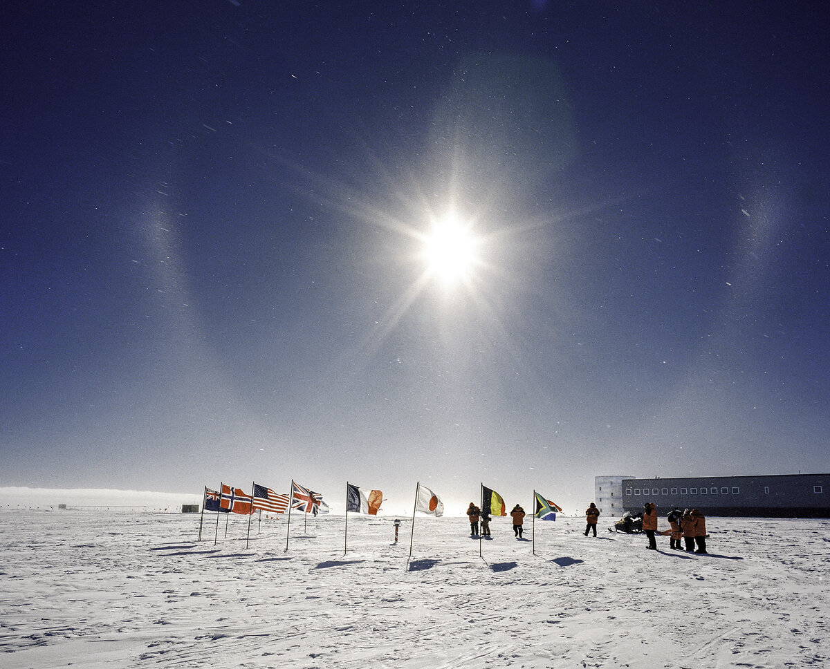Guests take photographs at the Ceremonial South Pole