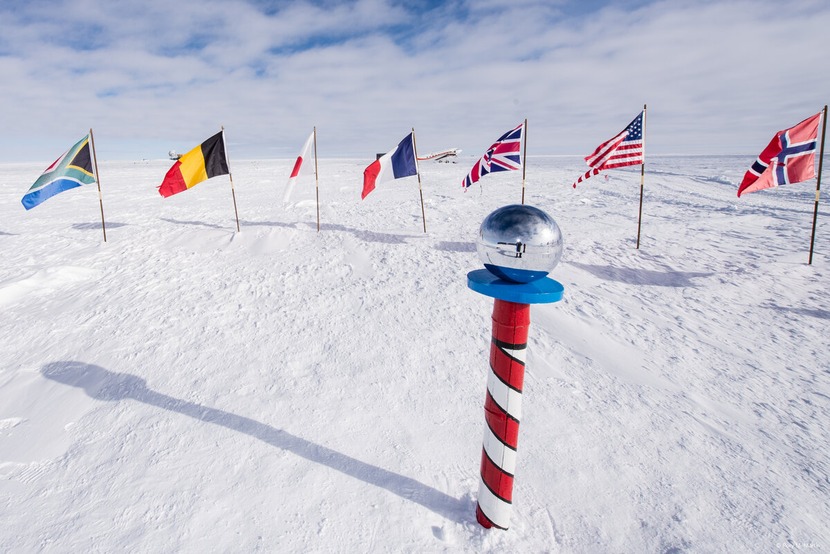 Ceremonial South Pole and flags of Antarctic Treaty nations