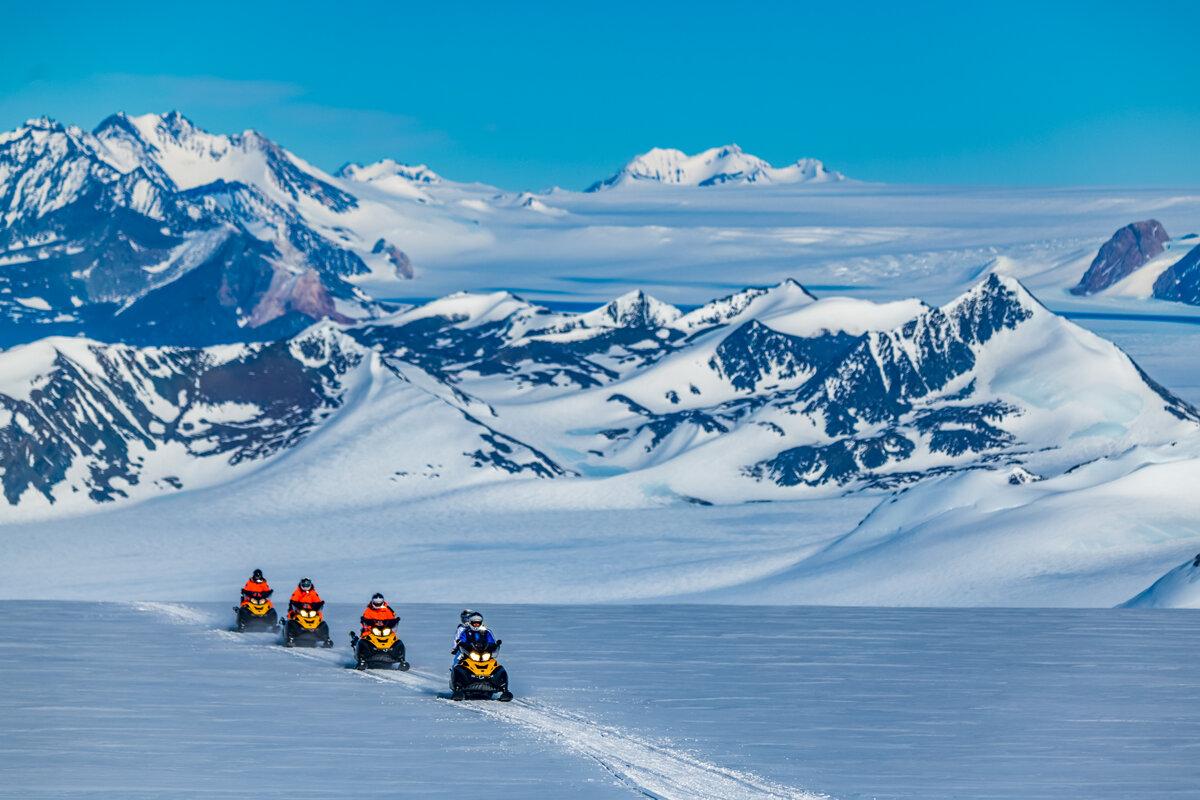 Guests on a snowmobile safari