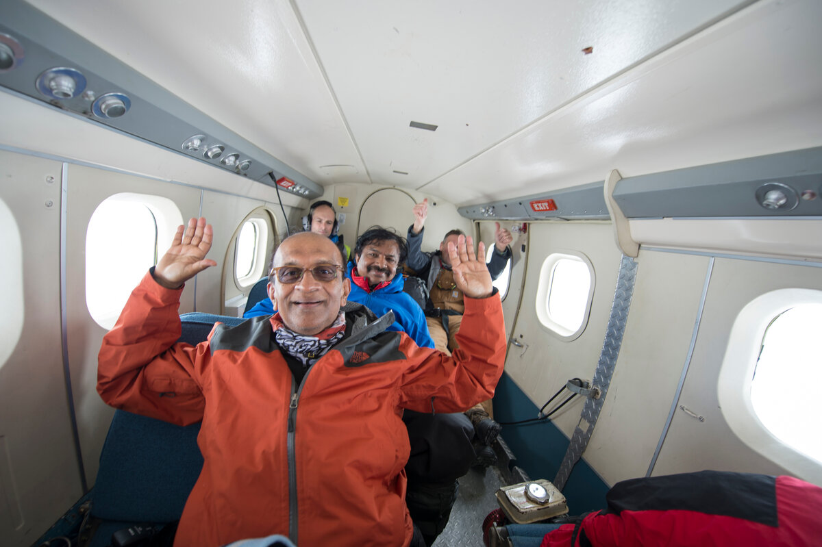 Guests celebrate as the Twin Otter aircraft takes off