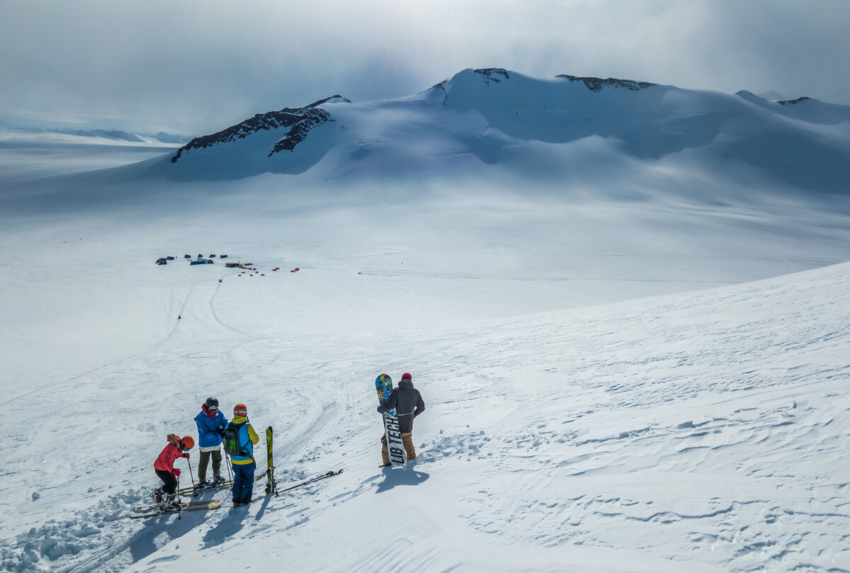 Guests ski and snowboard above Three Glaciers Retreat