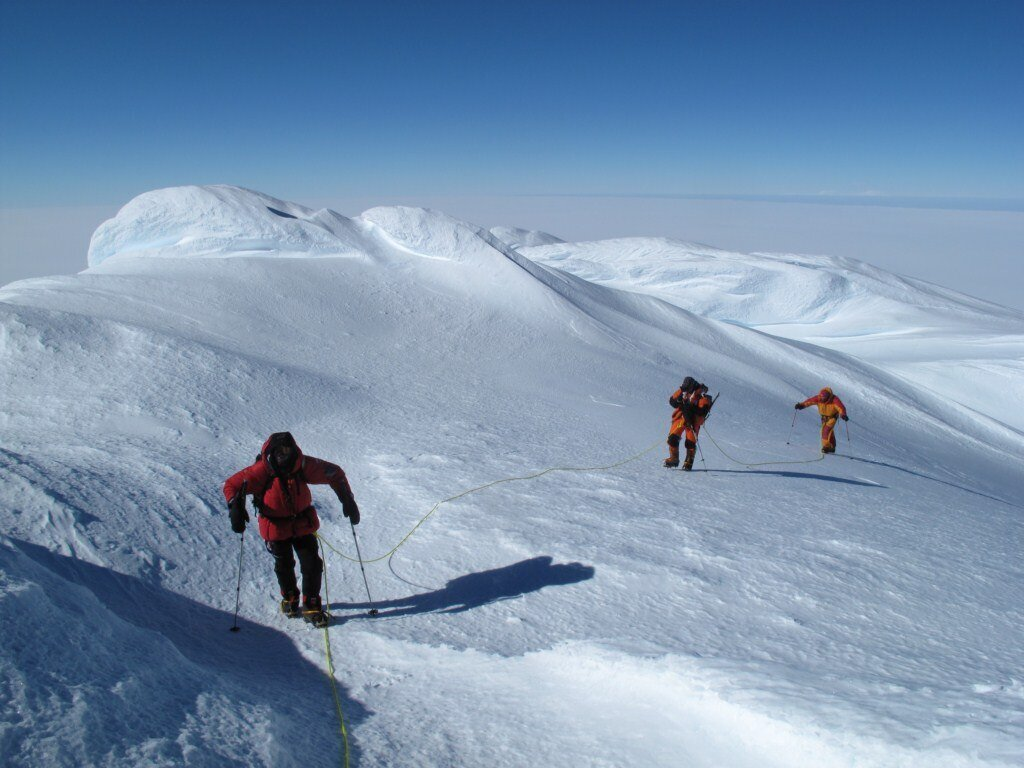Roped travel past snow rime 'mushrooms' on summit ridge