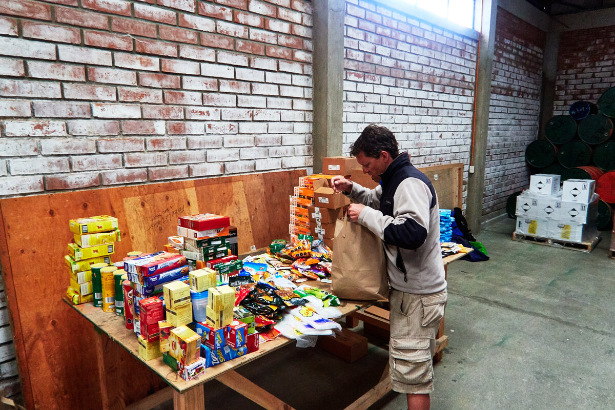 Expeditioner packs food in ALE's warehouse in Punta Arenas