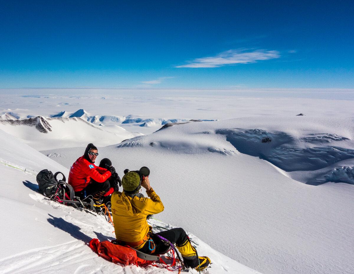 Two climbers take a break to enjoy sunshine and views