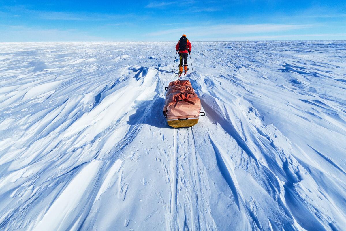 Skier picks his way through ridges of sastrugi
