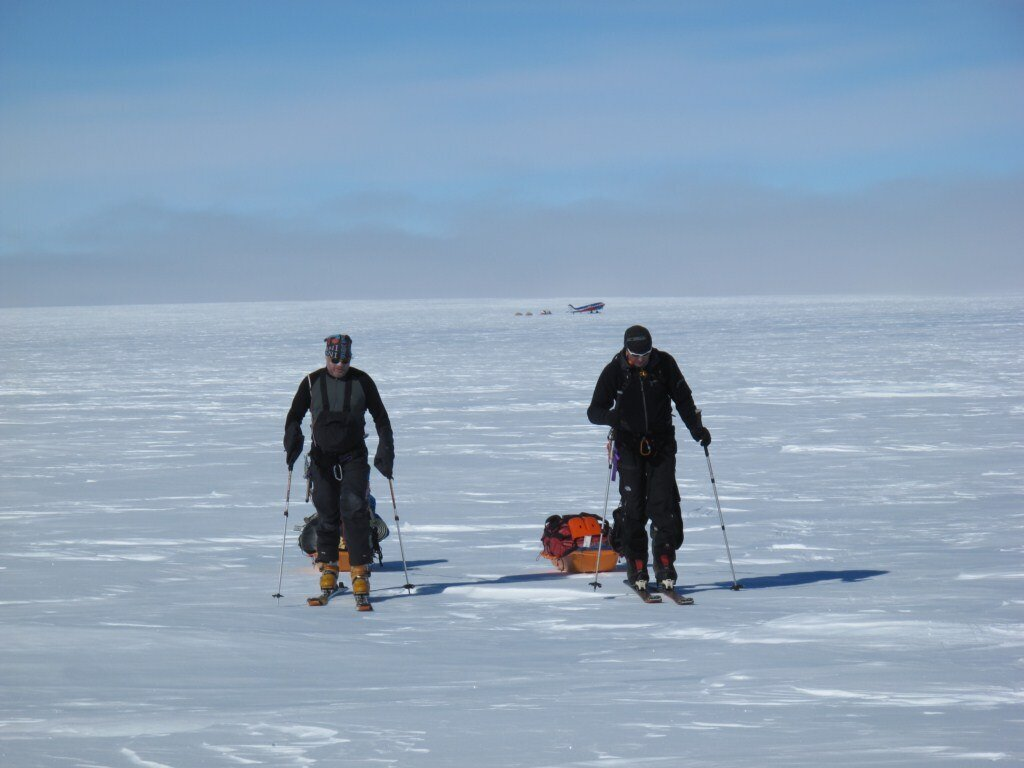 Climbers set off from base camp with skis and sleds