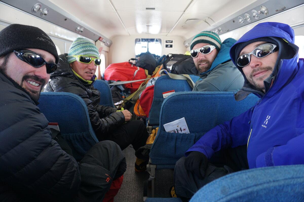Passengers sit inside Twin Otter ready to depart