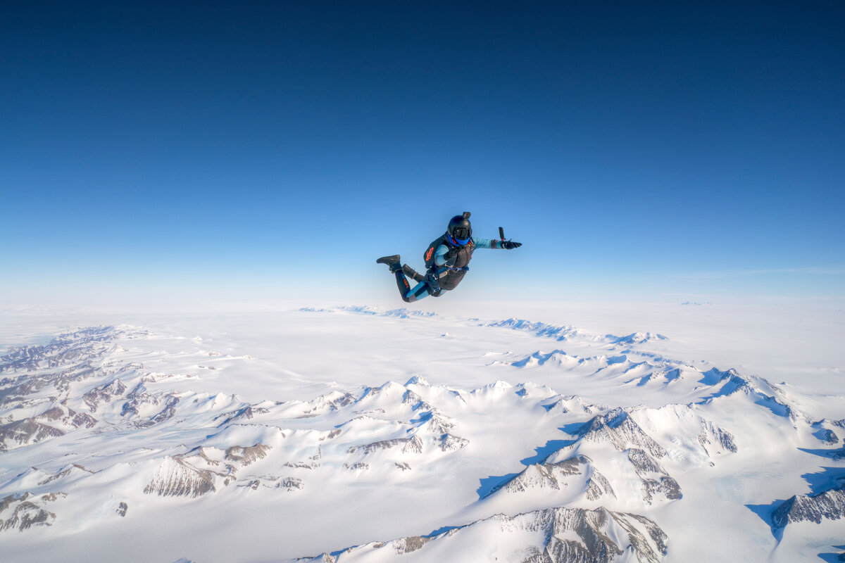 A skydiver in free fall over Union Glacier