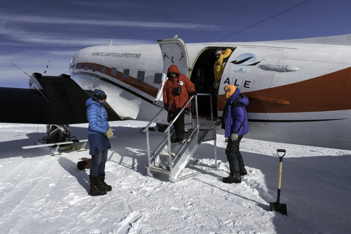 A guest de-planes from the Basler aircraft, after landing at the South Pole