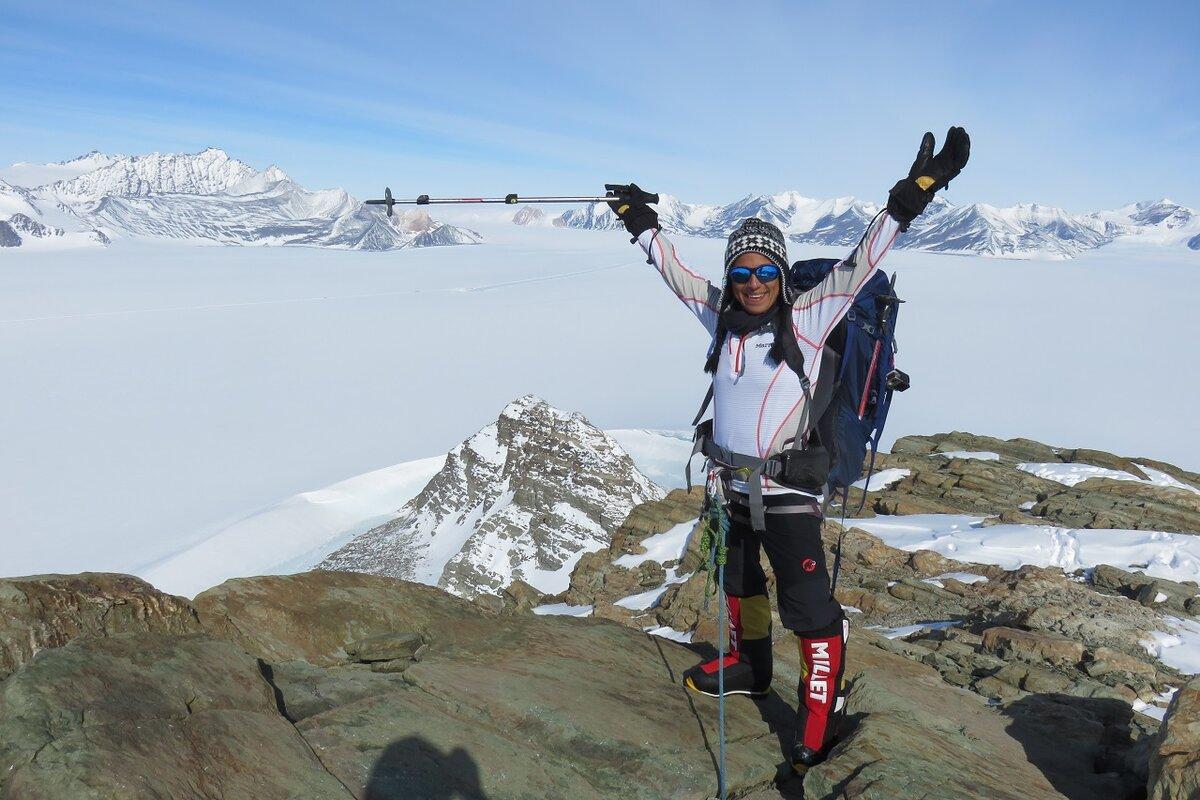 Climber on top of Charles Peak