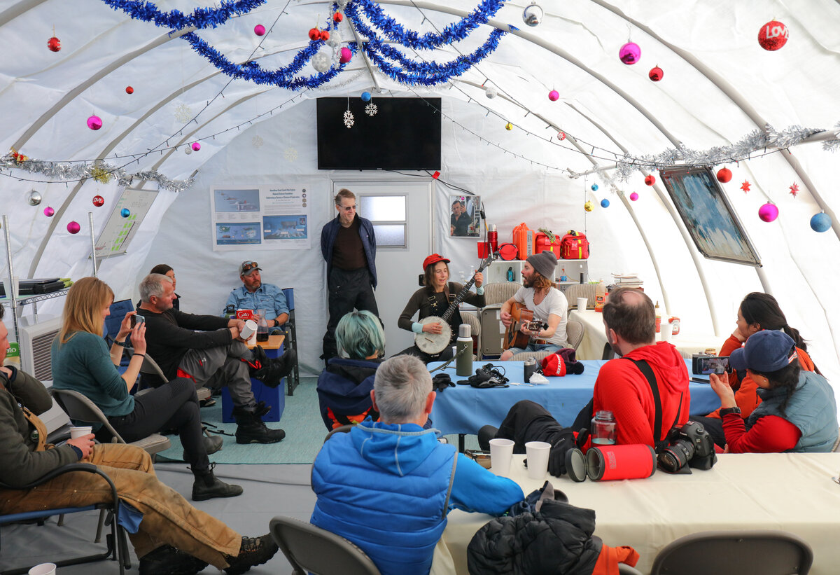 Guests listen to live music at ALE South Pole Camp on New Year's Eve