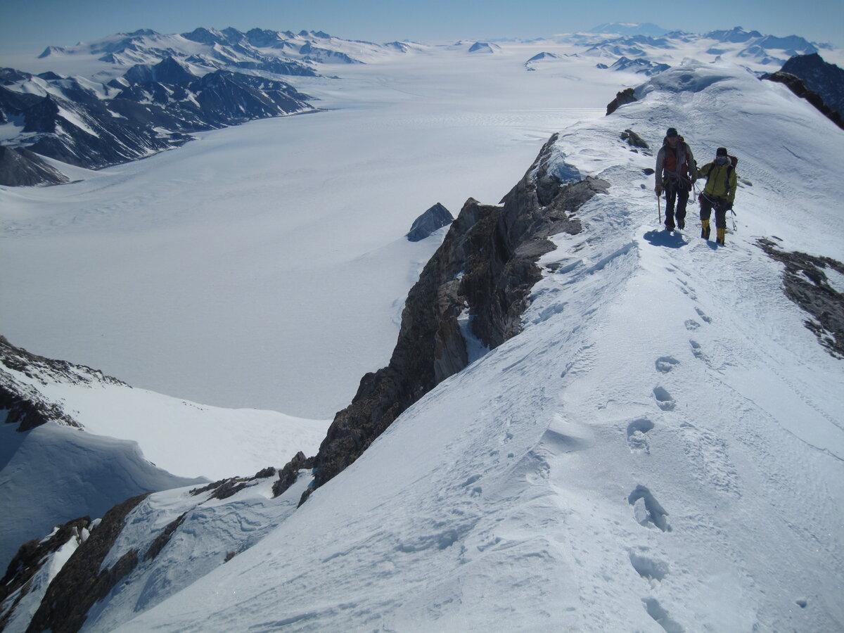 Climbers traverse southeast ridge on Guarcello Peak