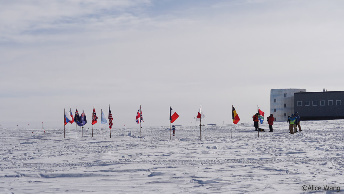 A group of guests take photos at the Ceremonial South Pole