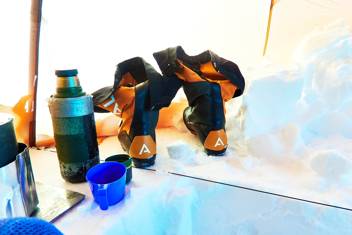 Expedition ski boots set to dry inside tent vestibule
