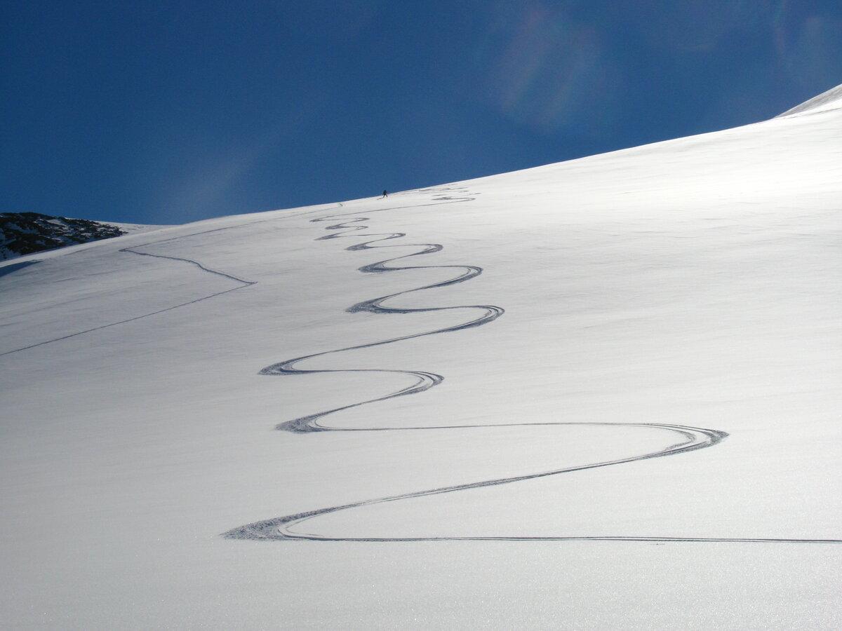 Ski tracks on a pristine slope near Three Glaciers