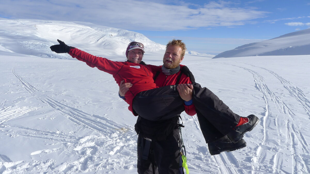 Team members celebrate arriving on the polar plateau