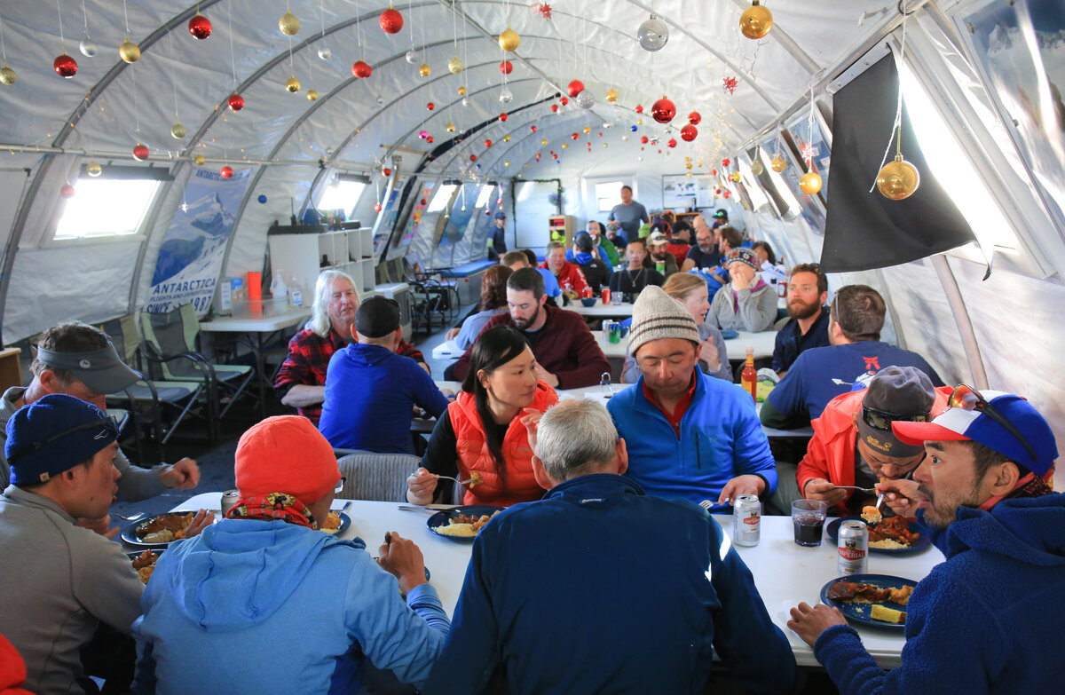 Guests gather for a meal in the dining tent at Union Glacier