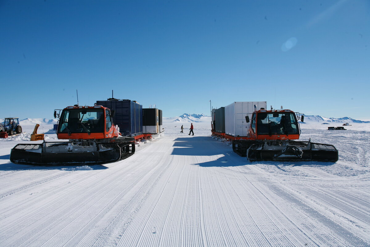 Two BR-350 tractors pull loaded sledges