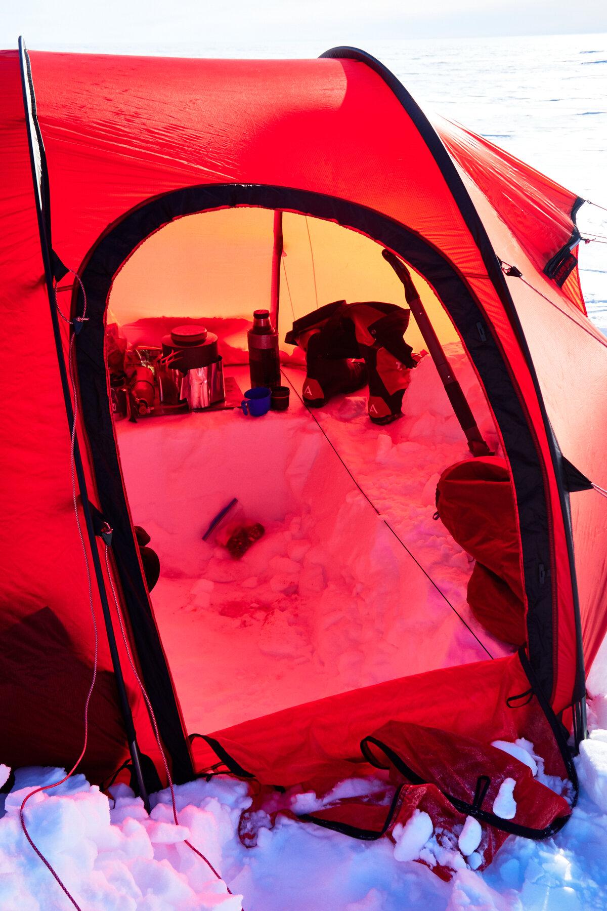 Snow kitchen inside tent vestibule
