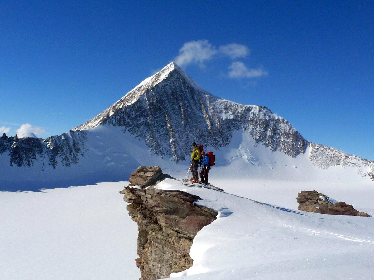 Climbers in front of Mount Allen