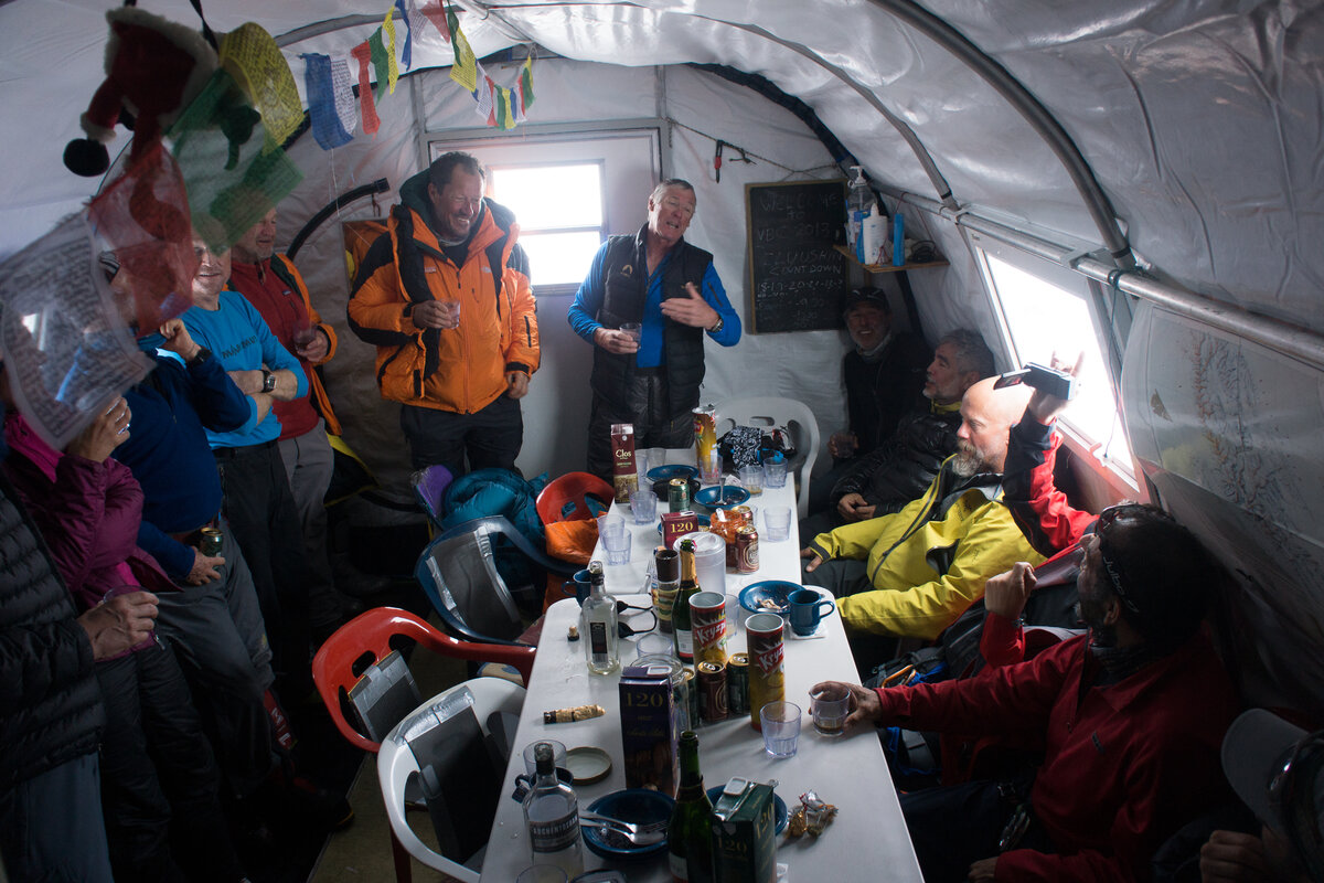 Climbers celebrate at Vinson Base after a successful climb
