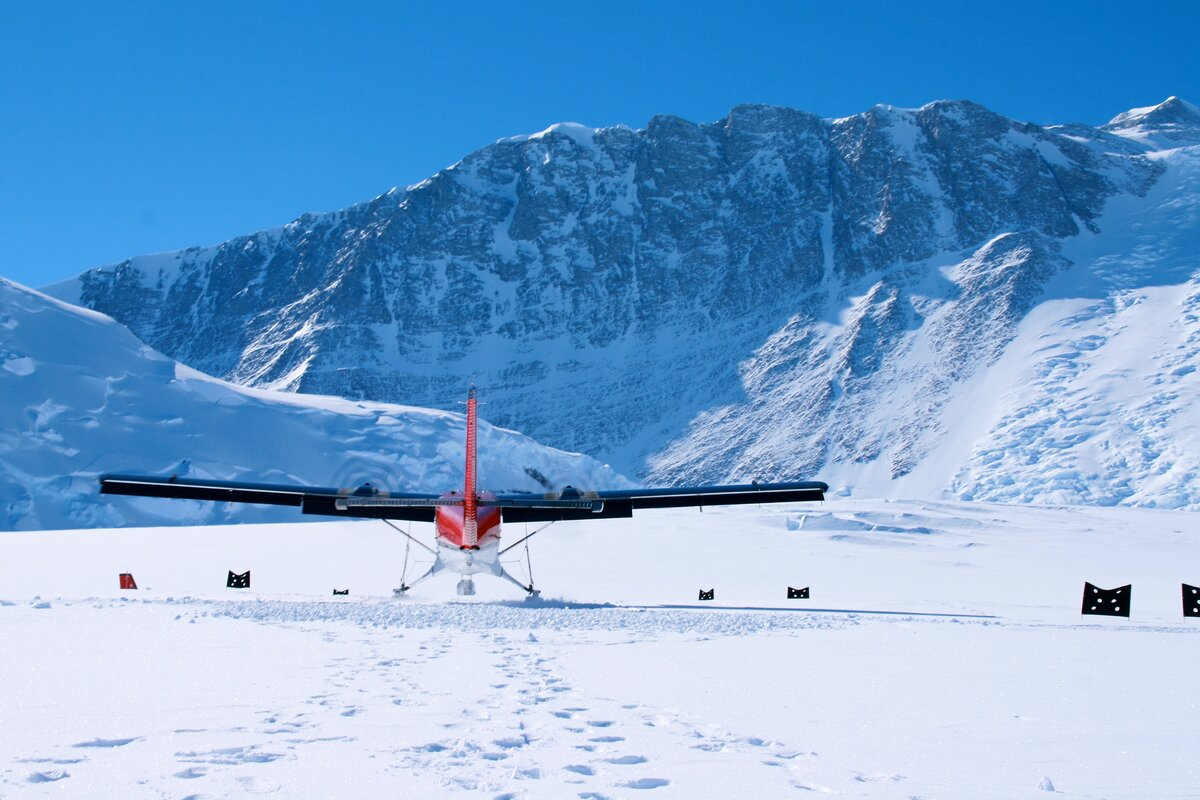 Twin Otter aircraft lands on the skiway at Vinson Base