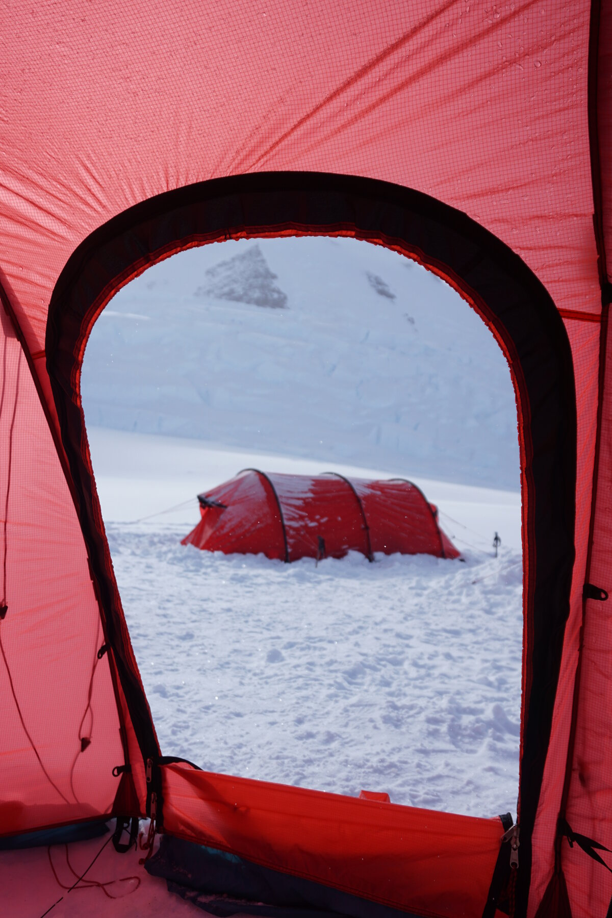 View of a frost covered red Hilleberg tent