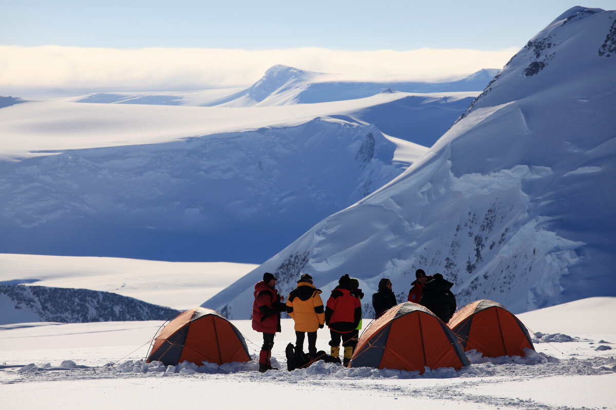 Climbers chat beside their sleeping tents